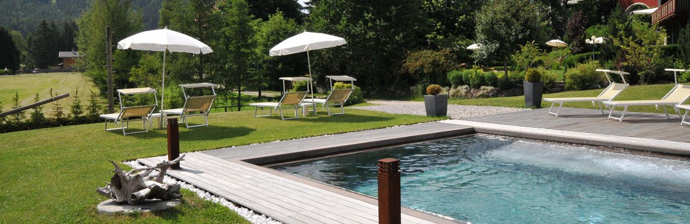 Hotel Santer garden with swimming pool in Dobbiaco